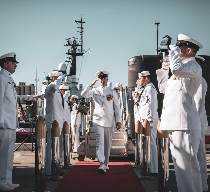 military personnel saluting