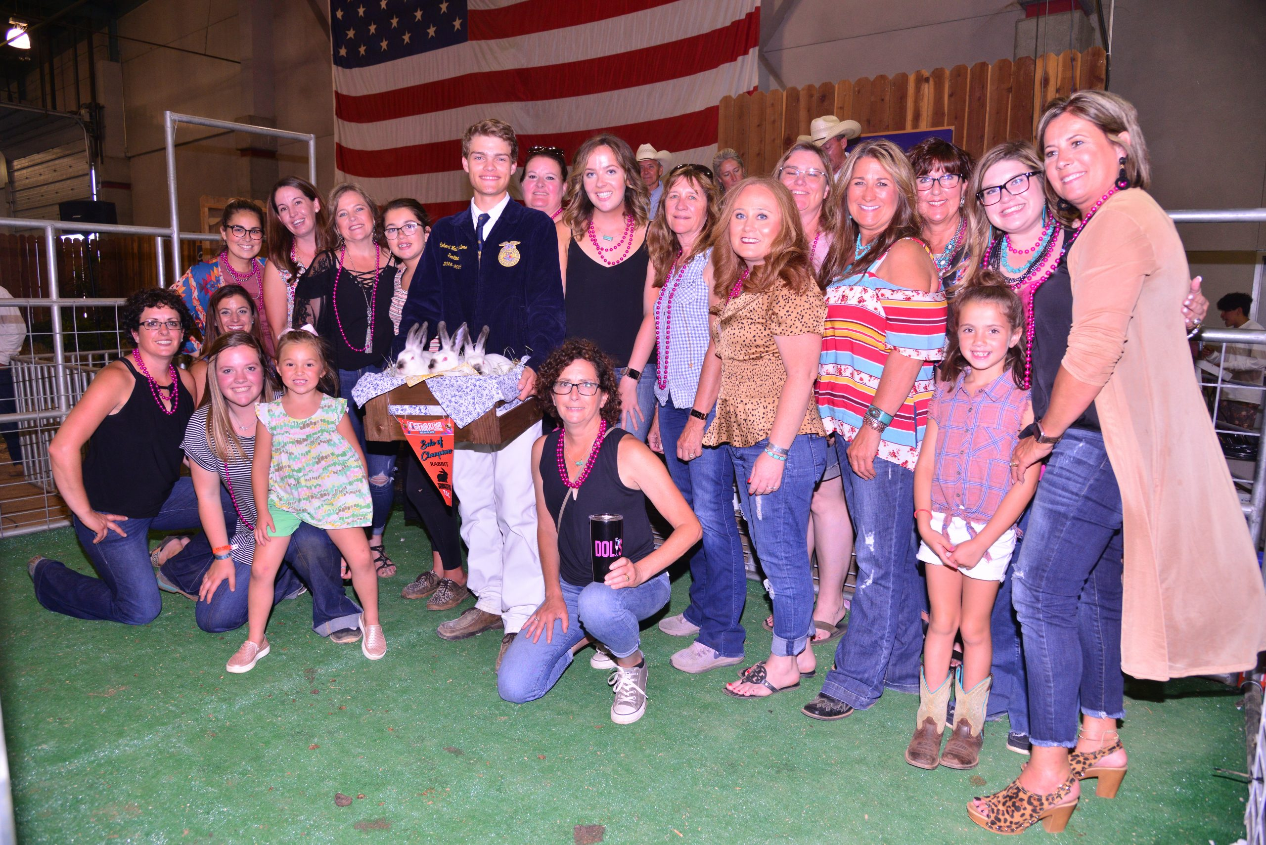 Grand Champion Meat Pen with Exhibitors and Buyers