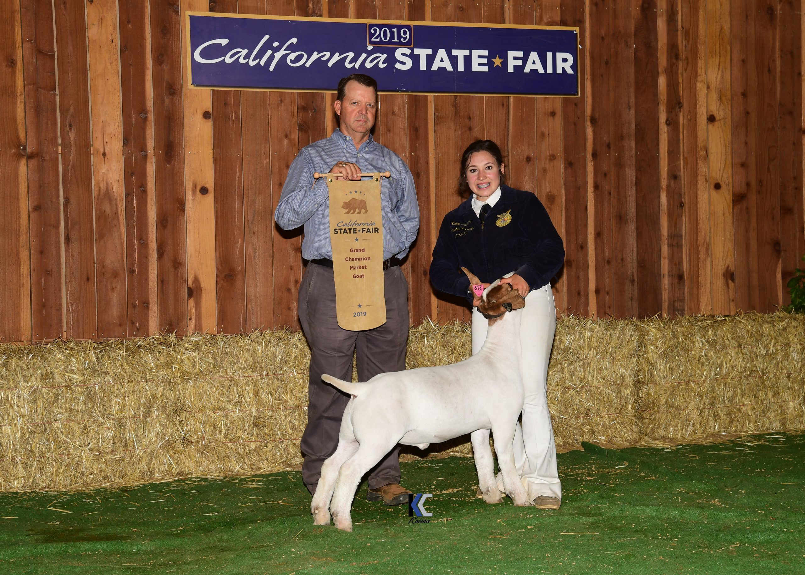 Grand Champion Market Goat with Exhibitor and Judge