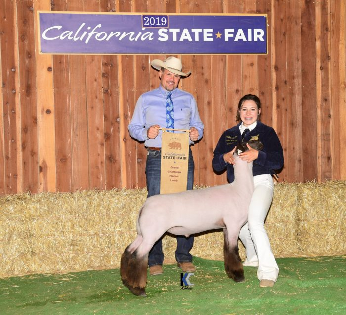 Grand Champion Market Lamb and Exhibitor with Judge