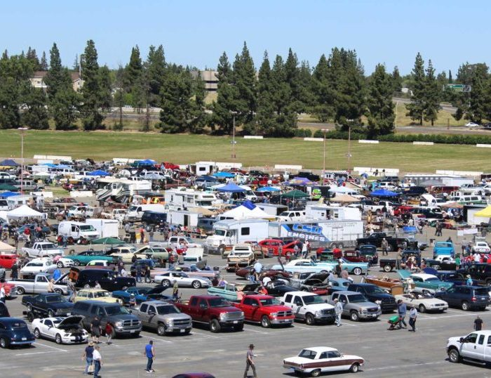 Picture of lots of cars in a parking lot ready for the swap meet