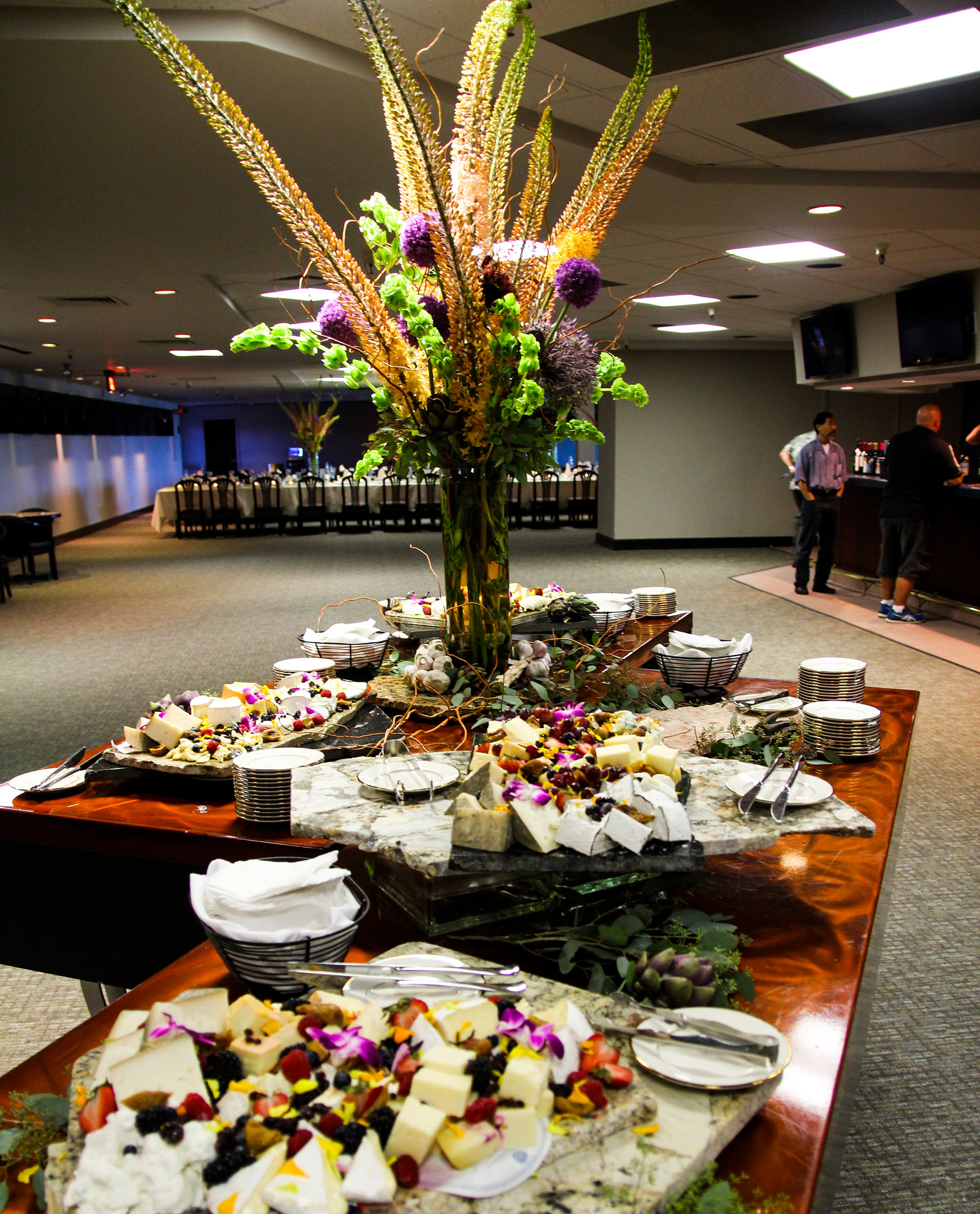 Large table of food and large flower arrangement