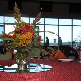 Table with large floral arrangement