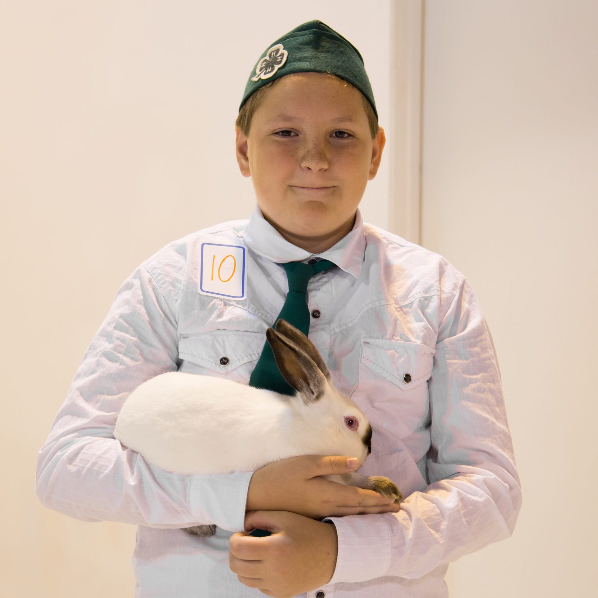 A young boy holding a rabbit