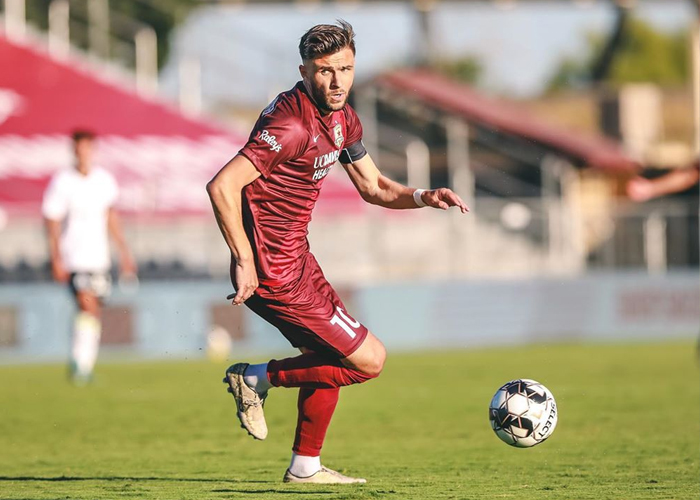 Sac Republic Player on a field with a soccer ball