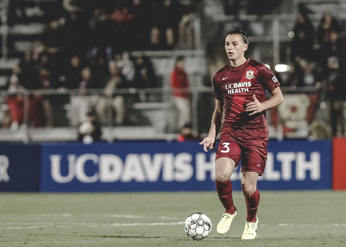 Sac republic FC player about to hit a soccer field in the middle of the field
