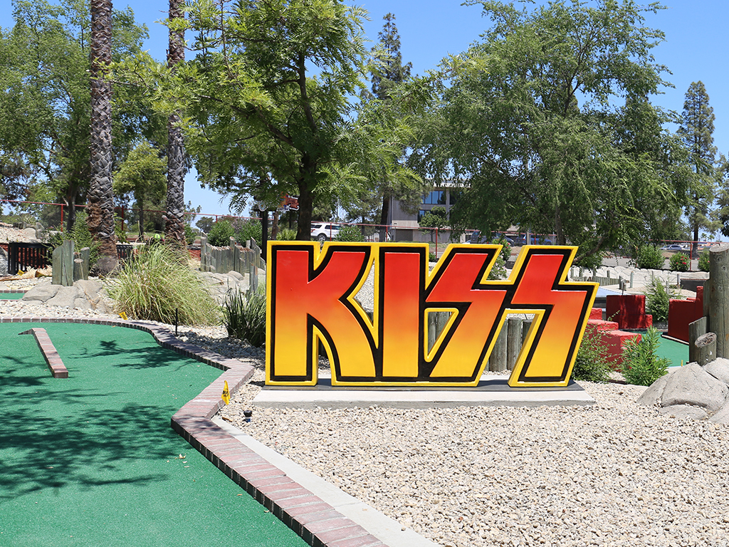Mini Golf course with Kiss band letter decorations